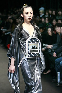 Model, dressed with dress with LCD display from the collection autumn-winter 2007 of Emiko Miki during the Japanese week of the fashion